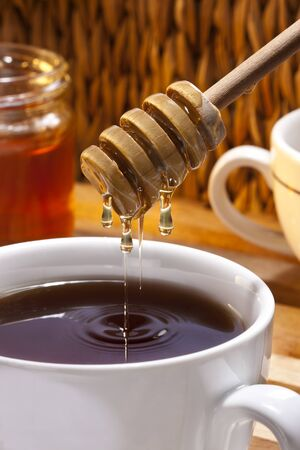 Making tea with honey.