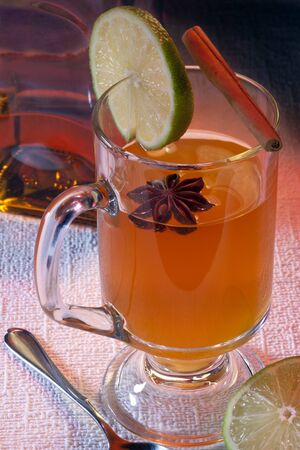 The traditional Scottish preparation of a hot toddy involves the mixture of tea, whiskey, boiling water, and sugar or honey. Additional ingredients such as cloves, star anise, a lemon or lime slice or cinnamon may be added. They are believed to help cure colds and flu.