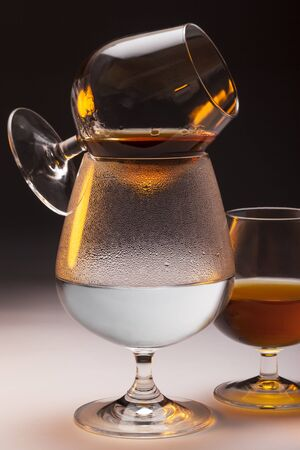 Cognac - Warming French Brandy in Brandy Snifters over hot water. Brandy is a spirit produced by distilling wine. Stockfoto