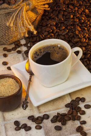 Cup of Coffee - Coffee is a brewed beverage prepared from the roasted seeds of several species of an evergreen shrub of the genus Coffea. Stockfoto