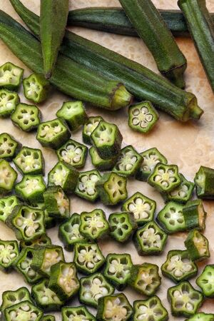 Okra is a plant of the mallow family with long ridged seed pods, native to the old world tropics. Also known as ladies fingers, bhindi, bamia, or gumbo,