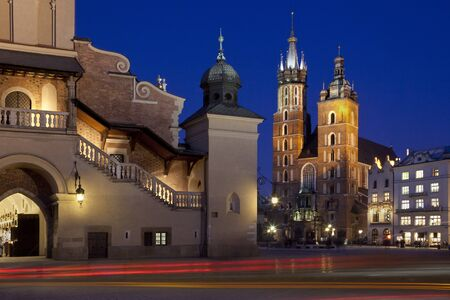 The Church of St Mary and the south end of the Cloth Hall in the Main Square (Rynek Glowny) in the city of Krakow in Poland. The gothic basilica is also known as the Church of the Assumption of the Virgin. Dates from the late 13th Century.