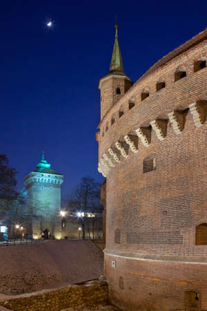 The Barbican, Krakow, Poland. It is a circular bastion constructed in 1498 and originally surrounded by a moat. The tower is St. Florians Gate, one of the entrances to the old medieval walled city.