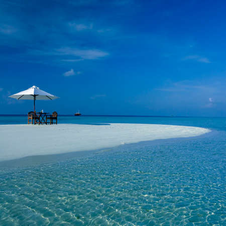 Tropical island paradise in South Ari Atoll in the Maldives in the northern Indian Ocean.