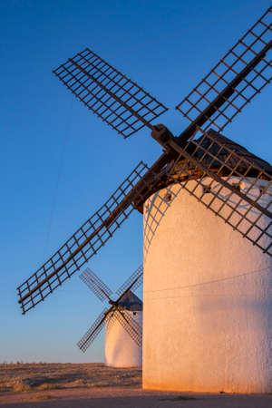 Late afternoon sunlight on the windmills in Campo de Criptana in the La Mancha region of central Spain.