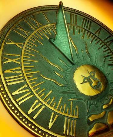 Sundial -  a device that tells the time of day when there is sunlight by the apparent position of the sun in the sky. Stock Photo
