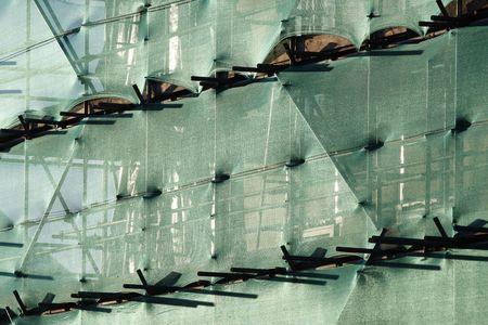 netting: Nieuw gebouw met steigers en groene verrekening
