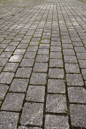 converging: Cobblestone path pattern background, converging perspective