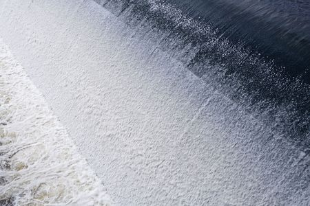 Fast flowing tidal weir, diagonal abstract perspective