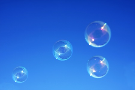 Bubbles against a graduated blue sky background