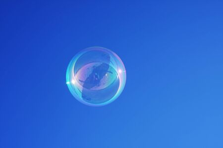 Bubble against a graduated blue sky background