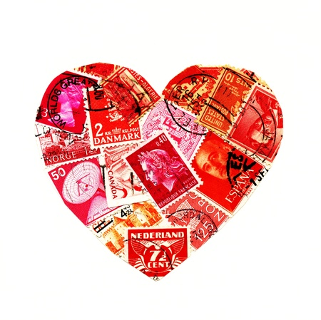 Red stamps from different countries in the shape of a heart isolated on white