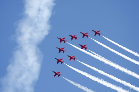 high flown: Red Arrows formation flying against a blue sky