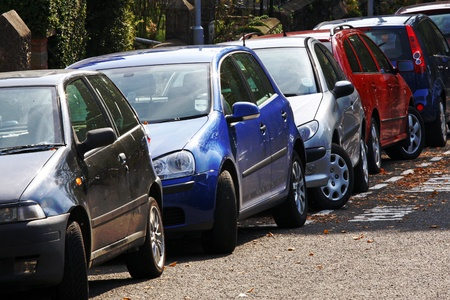 cramped space: Cars tightly parked in an urban street