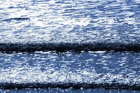 high contrast: Small waves breaking on a beach, high contrast
