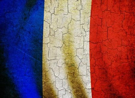 Bandiera francese su uno sfondo grunge cracking