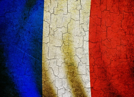 French flag on a cracked grunge background photo
