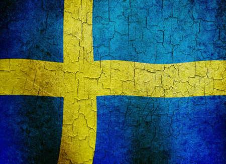 Swedish flag on a cracked grunge background photo