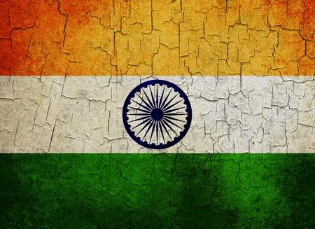 Indian flag on a cracked grunge background photo
