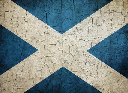 Bandera escocesa sobre un fondo grunge agrietado