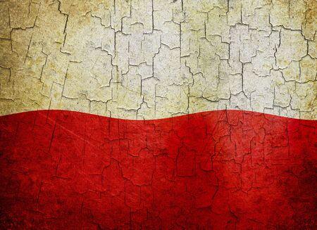 Polish flag on a cracked grunge background photo