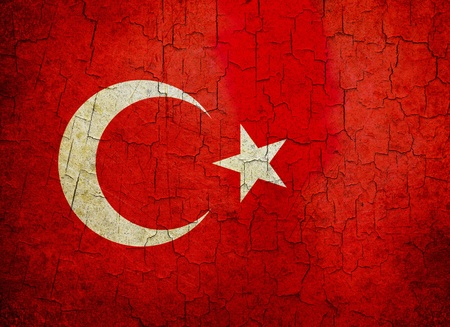 Turkish flag on a cracked grunge background photo