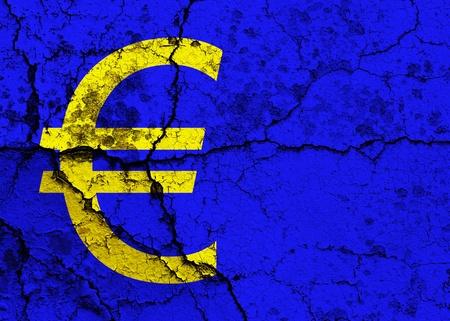 Euro symbol on a cracked grunge background Stock Photo