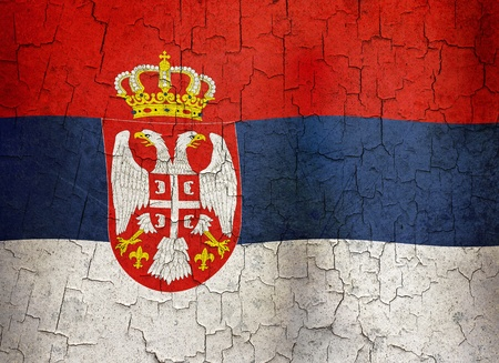 Serbian flag on a cracked grunge background photo