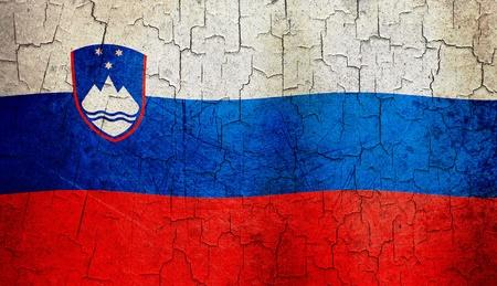 slovenian: Slovenian flag on a cracked grunge background Stock Photo