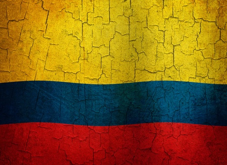 Colombian flag on a cracked grunge background photo