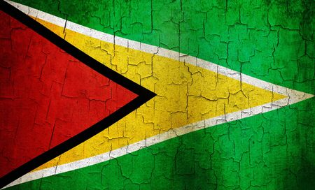 Guyanese flag on a cracked grunge background Stock Photo - 12191315