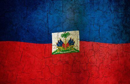 haitian: Haitian flag on a cracked grunge background  Stock Photo