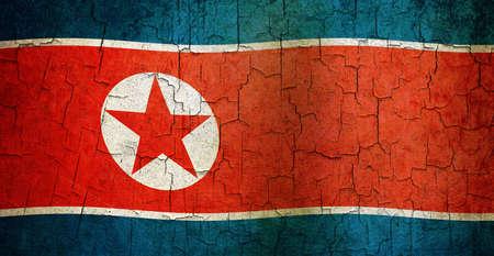 North Korean flag on a cracked grunge background Standard-Bild