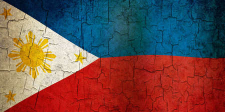 Philippines flag on a cracked grunge background photo
