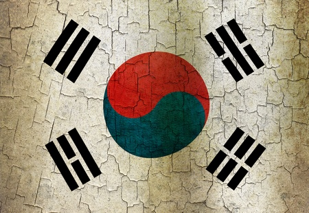 South Korea flag on a cracked grunge background photo