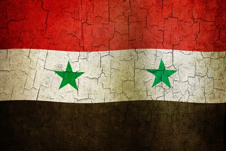 Syrian flag on a cracked grunge background photo