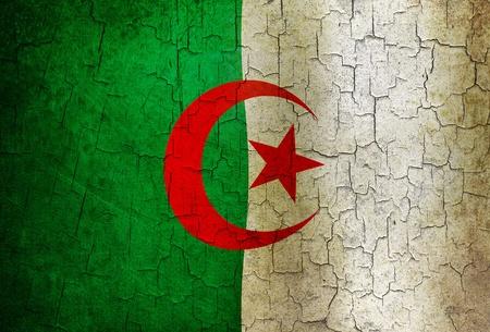 Algerian flag on a cracked grunge background photo