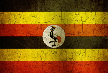 Uganda flag on a cracked grunge background