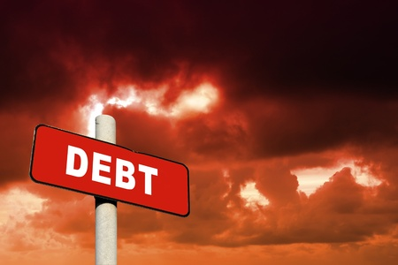 Red debt sign against a red sky