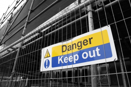 Danger Keep Out sign with black and white background photo