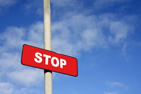 Red stop sign against a blue sky Stock Photo - 14229011