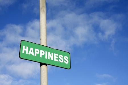 La felicit� segno verde contro un cielo blu Archivio Fotografico