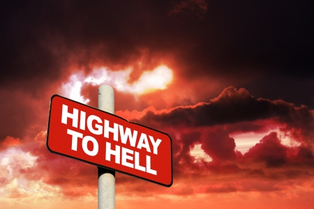 Highway to hell sign against a red sky
