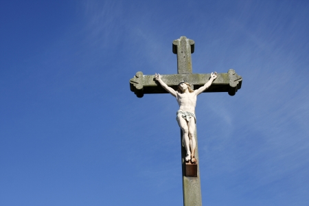 Jesus Christ crucifixion sculpture against a blue sky photo