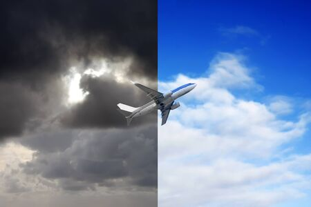 two and a half: Plane flying out of stormy sky into blue sky Stock Photo