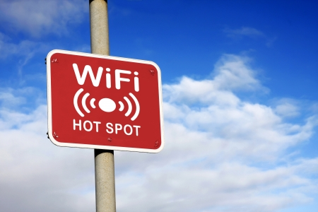WiFi hotspot sign against a blue sky
