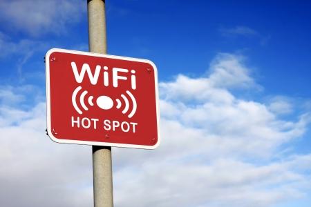 WiFi hotspot sign against a blue sky