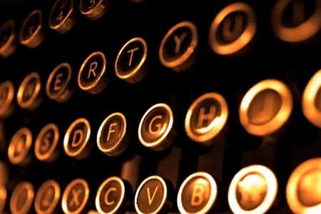 the author: Antique typewriter keys close up, selective focus