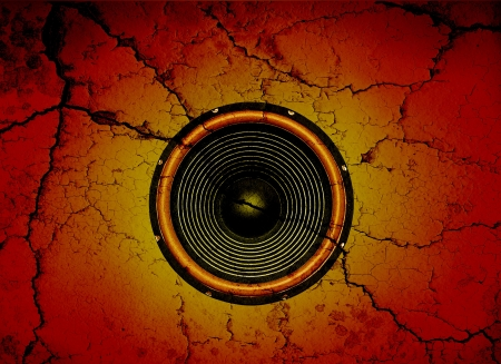 Audio speaker on a cracked wall background