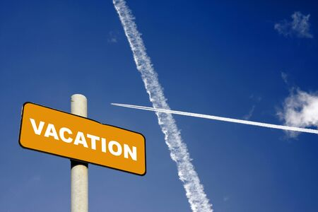 Vacation sign with jet trails crossing in a dark blue sky Stock Photo - 17538878